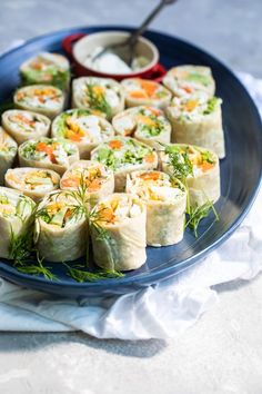 People just can't get enough of Veggie Tortilla Roll Ups at parties. This make-ahead recipe is full of colorful crunchy veggies and creamy herb filling, all rolled up into an easy-to-eat finger food. Make an extra tray, because you'll need it. #tortillarollup #wraps Tortilla Rolls, Roll Ups Tortilla, Roll Ups Recipes, Wrap Recipes, Appetizers For Party, Appetizer Recipes, Party Recipes, Drink Recipes, Holiday Recipes