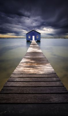 I often drive past this unnoticed boat-shed. Herein lies the beauty of simplicity.   Little Blue - Blue Boatshed, Perth, Australia by Leah Kennedy.