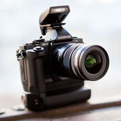 olumpus OM-D. my next camera for sure. pc mag gives it 5 out of 5 stars.