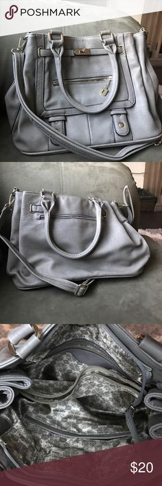Grey purse This purse is gray with gold detailing. Has lots of pockets to hold all your stuff. On the inside there is a middle pocket dividing the 2 big pockets. It also has handles and a long strap for cross body. It is used but in good condition! JustFab Bags Crossbody Bags
