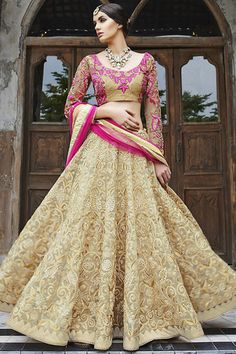 Beige and Pink Heavy Embroidered Bridal Lehenga