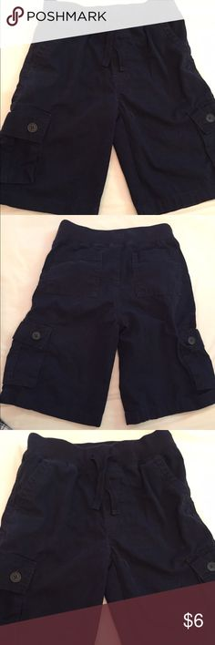 Gymboree Navy Pull On Cargo Shorts Size 10. Gymboree elastic waist with drawstring Cargos in 100% cotton. Wide band at waist. Cargo pockets with a wider comfortable fit at sides. Additional rear pockets. A little fading. Good used condition. Thanks! Gymboree Bottoms Shorts