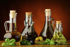 Three Different Olive Oil Bottles. Stock Image - Image of cook, bottle: 25512717 Green Fruit, Olive Fruit, Seasoning For Fish, Cheese Club, Colored Glass Bottles, Italian Olives, Olive Oil Bottles, Cooking Instructions, Hacks
