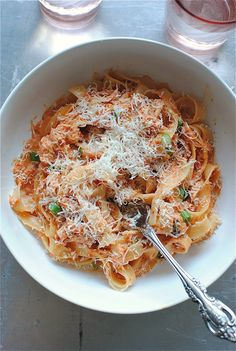 ---Creamy Tomato and Crab Fettuccine---  *serves 2*  * 1 Tbs. extra-virgin olive oil  * 3 cloves garlic, minced  * 2 Tbs. tomato paste  * 3 cups cherry tomatoes, blitzed in a food processor until smooth  * 1/2 cup heavy cream  * 5 basil leaves, torn  * 1 (6.5 oz) can jumbo lump crab meat  * 1/2 pound fettuccine  * pinch of coarse salt and freshly ground pepper