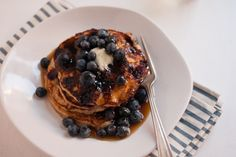 Delicious blueberry-studded pancakes made with oat flour, so they are gluten free! No crazy ingredients required.