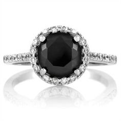 Real and Faux: The Faux Carrie Bradshaw #engagment_ring is sterling silver set with simulated black and white diamonds.