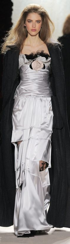 Nina Ricci fall 2010  -  Bag the open seams on the legs.  Otherwise, a nice formal look