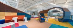 Be sure to take notice of the playful, colorful lounge that NUCA Studio partner Ionel Pascu and his partner, Robert Marin, designed at Bucharest He. Corporate Office Design, Corporate Interiors, Office Interiors, Commercial Design, Commercial Interiors, Visual Merchandising, Colourful Lounge, Architecture Jobs, Airport Lounge