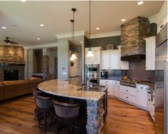 Beautiful stone in kitchen; open floor plan.