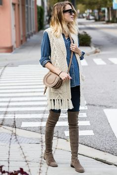 fall / winter - street style - street chic style - casual outfits - denim shirt + cream chunky knit fringe vest + dark denim skinny jeans + light brown over the knee boots + black sunglasses + nude shoulder bag Over The Knee Boot Outfit, Over The Knee Boots, Crochet Vest Outfit, Knit Vest, Fall Winter Outfits, Autumn Winter Fashion, Fall Fashion, Fashion Trends, Vest Outfits