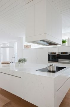 All white stone kitchen with Miele appliances