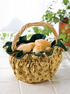 Autumn Gift Basket Sewing Pattern Download from e-PatternsCentral.com -- Our reversible round basket cover features summery sunflowers on one side and fall leaves on the other, but you may choose any seasons or themes that suit your fancy.