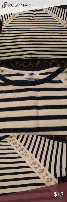Cute Striped Crop Top Cute and trendy striped crop top. Navy blue and cream colored stripes with a lacy opening on each sleeve. It comes past the belly button. Looks great with jeans! Old Navy Tops Crop Tops