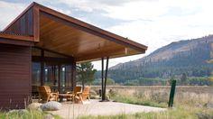 Weathering-steel volumes wrap courtyard at Washington holiday home