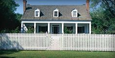 I love the classic picket white fence. I really like this old fashioned home as well. I guess I'm kind of old fashioned and so that's why this appeals to me.