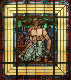 Glass window with the image of a mine worker, Charleroi, Belgium