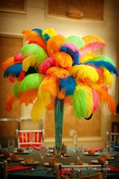 Brightly colored feathers were perfect for these Bat Mitzvah centerpieces! | MitzvahMarket.com