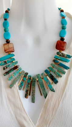 Check out this item in my Etsy shop https://www.etsy.com/listing/247166708/turquoise-fan-necklace-tribal-turquoise