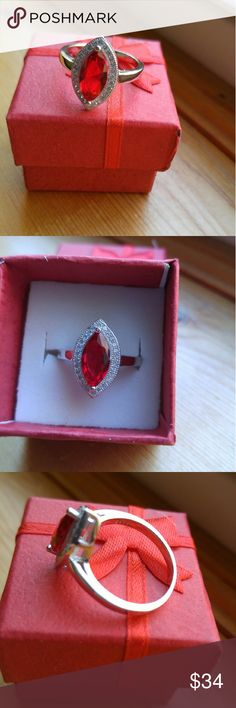 Size 8. 3 CT Marquise cut Ruby & White Topaz Ring 3 CT Marquise cut Ruby & White Topaz Ring. Stamped 925 Sterling Silver. Listed 11/12/16. Size 8. ???????? Jewelry Rings