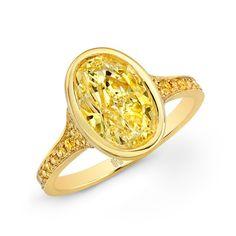 Rahaminov Diamonds ~ Yellow Bezel ring with bezel set fancy yellow oval-shaped diamond, accented with fancy yellow diamond melee set, in 18k yellow gold.