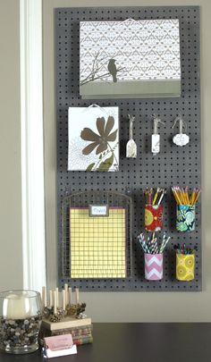 Paint a piece of pegboard to add character to your space. We also wrapped recycled soup cans with gift wrap to give a pop of color.