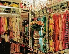 We're loving the mirrored chest in this opulent closet