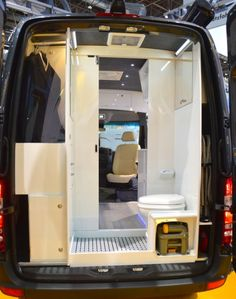 The Mercedes Sprinter's rear houses a bathroom with integrated wardrobe closet.