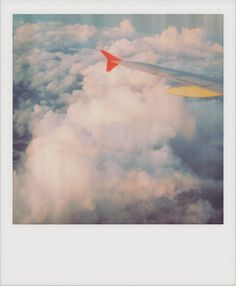 Flying in an airplane. This is caught on polaroid. Film photography is one of her interests and she takes her film with her everywhere to snap photos of her travels.