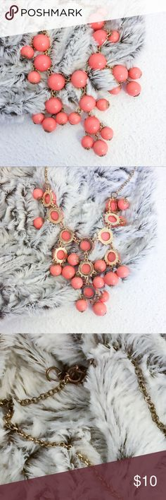 """Pink Salmon Bubble Statement Necklace 24"""" Chain Light Pink Salmon Bauble Necklace  This cute necklace is a light pink color that lends itself toward a salmon color. Total chain length is 24"""" and the longest bauble hangs about 3"""". Depending on where you clasp the necklace his would be considered a matinee or opera length necklace (see chart). I have similar necklaces in different lengths and colors in my closet.  Note: Clasp does show some slight tarnishing but otherwise it's in great…"""