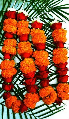 Garland with Marigolds & Roses by Hi'aka Florist, San Francisco   #Marigold_Garland #Hi'aka_Florist