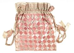This bag, from c1860, is made up of a chequered design of plaited ribbon work.