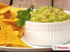 Vitamix Guacamole - 1 medium tomato, halved or 3/4 cup chopped  1/2 cup (10 g) fresh cilantro leaves  1/4 cup (40 g) chopped onion  2 Tbsp (30 ml) lemon juice  1 tsp salt  2 ripe avocados, peeled, pitted