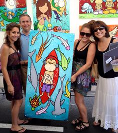 """This family all agreed that they wanted this piece to complete the look of the downstairs game room in their home. Acquired at the Westport Art Festival, the family was all too happy to pose with the """"Tranquil Surfer."""""""