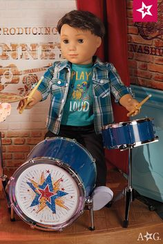 Logan's Rhythmic Drum Set. Logan is ready for rhythm! This metallic-blue set includes a bass drum with a working pedal and bright star design. It also includes a stool, a snare drum, a metal cymbal, two drumsticks that Logan can hold, and stands for the drums and cymbal.  $68 Logan Doll $115