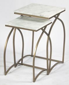 Nest of 2 tables in matte brass finish on iron with white marble tops.