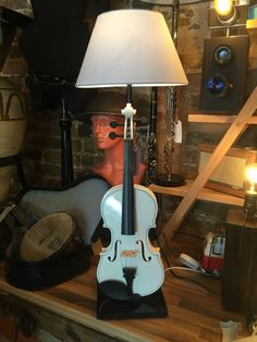 We then converted it into this magnificent lamp you see before you, the Violin is attached to a polished piece of black wood and comes compete with an on/off switch half way up the ample white flex to the 3 pin plug.