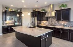 Love this kitchen with dark cabinets & light granite countertops - Before After DIY Light Granite Countertops, Backsplash With Dark Cabinets, Kitchen Countertops, Dark Cabinet Kitchen, Kitchens With Dark Cabinets, Backsplash Ideas, Expresso Kitchen Cabinets, Dark Wood Kitchen Cabinets, Dark Granite Kitchen