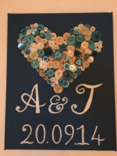 I made this for my brothers wedding as their wedding gift, the canvas is Teal the colour of the bridesmaids dresses and the buttons were cream and teal. I hand painted the letters and numbers in the style on the wedding invite.