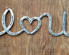 Items similar to Metal Wall Art Gift for Her - Nursery Wall Art - I Heart You - Country Home Decor - Anniversary Gift - Rustic Wall Decor - Horseshoe on Etsy Horseshoe Projects, Horseshoe Crafts, Horseshoe Art, Horseshoe Letters, Horseshoe Ideas, Metal Sculpture Artists, Steel Sculpture, Metal Walls, Metal Wall Art