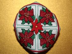 My own design for a Christmas poinsettia biscornu. Ideal as a tree ornament or little gift.