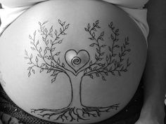 If I ever decide to actually have kids, I want to do belly henna. This is gorgeous.