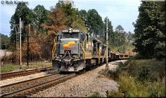 For comparison here is an example of Seaboard Coast Line's livery, worn by B36-7 #5830 as it heads up a southbound freight through Kennesaw, Georgia during May of 1986.