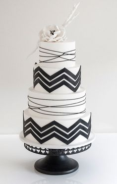 Black and white chevron wedding cake by Coco Cakes. Re-pin if you like. Via Inweddingdress.com #weddingcakes