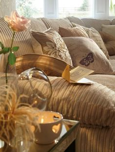 Soft Browns / Assortment of pillows, match the couch.  Monochromatic.