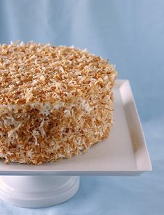 """Doesn't this coconut cake look absolutely delicious? Trust me when I say it tastes even better than it looks. Why the """"quadruple"""" in ..."""