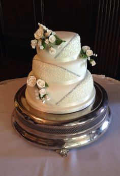 Ivory and diamanté wedding cake by  www.boutiquebakehouse.co.uk