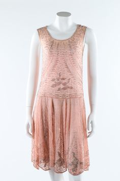 A beaded pink muslin flapper dress, circa 1928. adorned with a shimmer of silver floral swags, bust 81cm, 31in .