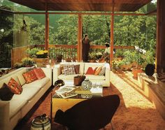 The glass walls overlooking the forest.