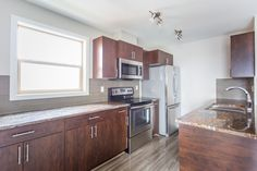 Velocity in Harbour Landing is a new condo community located in Regina's beautiful Harbour Landing New Condo, Kitchen Cabinets, How To Plan, Home Decor, Kitchen Cupboards, Homemade Home Decor, Decoration Home, Kitchen Shelves, Interior Decorating