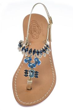 04918a5c3 Franca is an Italian sandal that features clear and dark blue crystals